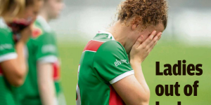 Mayo's Kathryn Sullivan with head in hands after defeat.
