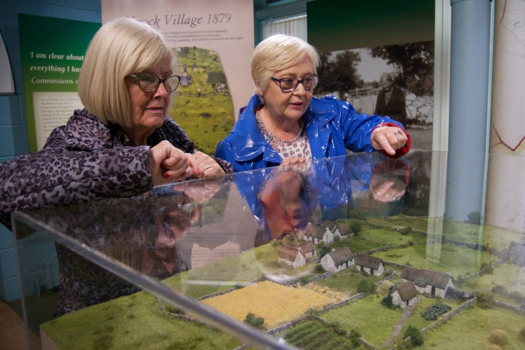 Locals view the model of Knock village.