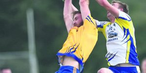 Knockmore's Shane McHale and Hollymount-Carramore's Michael Sheridan contest the ball