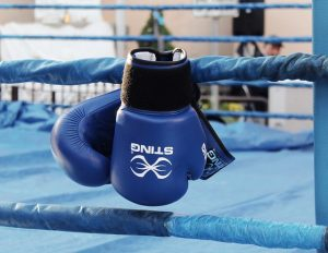 Boxing gloves hanging on ring