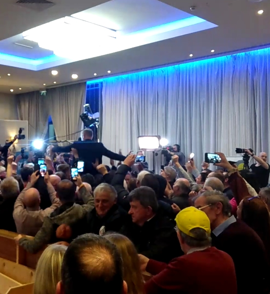 SF's Martin Kenny and supporters celebrate his election in the Sligo-Leitrim count centre.